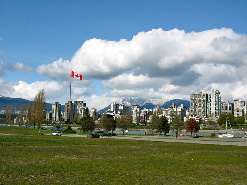 What is Vancouver, BC, Canada known for?  Beautiful view of downtown Vancouver, mountains, and park.